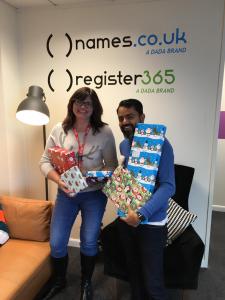 Caroline & Chirag with Christmas gifts